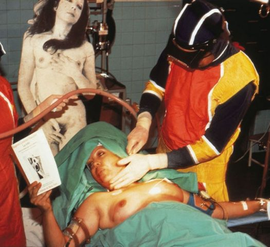 ORLAN Reading La Robe by Eugénie Lemoine-Luccioni, 1st Surgery-Performance, juillet 1990, Paris. Cibrachrome diasec mount, 165 m x 110 cm
